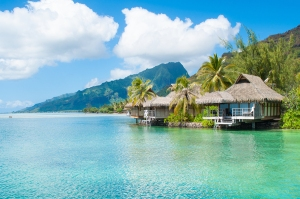 Bungalows in Tahiti. Blue green water