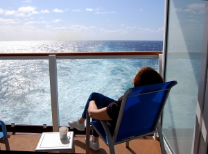Relaxing Passenger On Stateroom Balcony Aboard Ship On Transatla