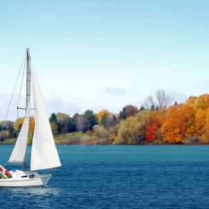 Canadian sailboat in the autumn with blue sky